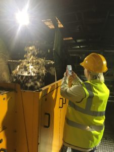 Sam taking a picture of the waste going through the Eddy Current